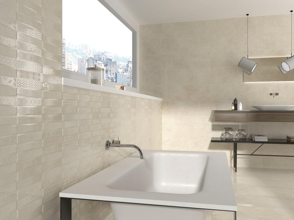 Lehce zvlněný světlý obklad se vzory do koupelny od výrobce Ape Excellence