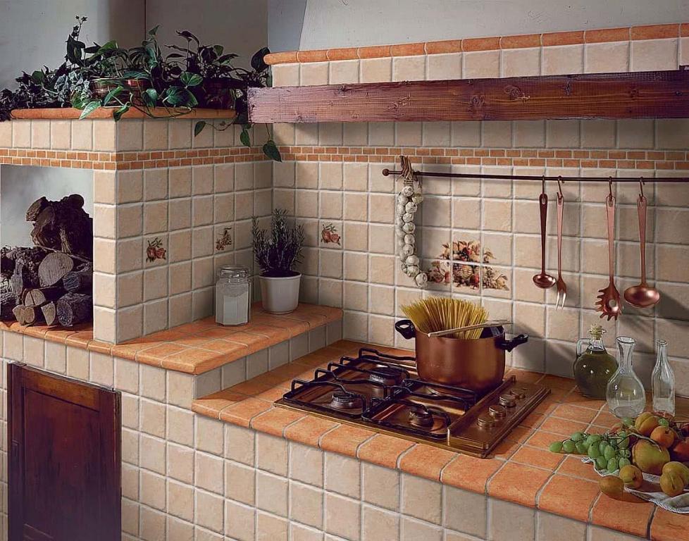 Oranžové a béžové obklady do kuchyně s motivem od výrobce Elios I Ciottoli