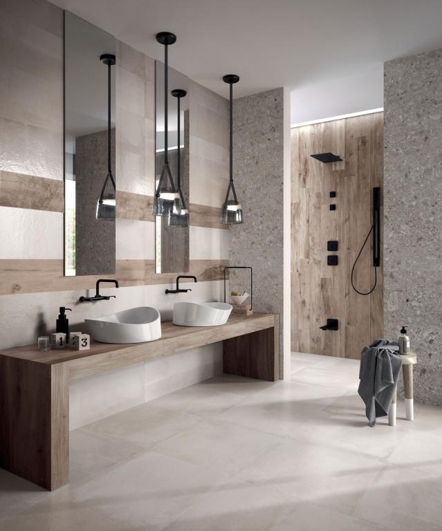 Světlé obklady a dlažba do koupelny od výrobce Ariana Ceramica Concrea