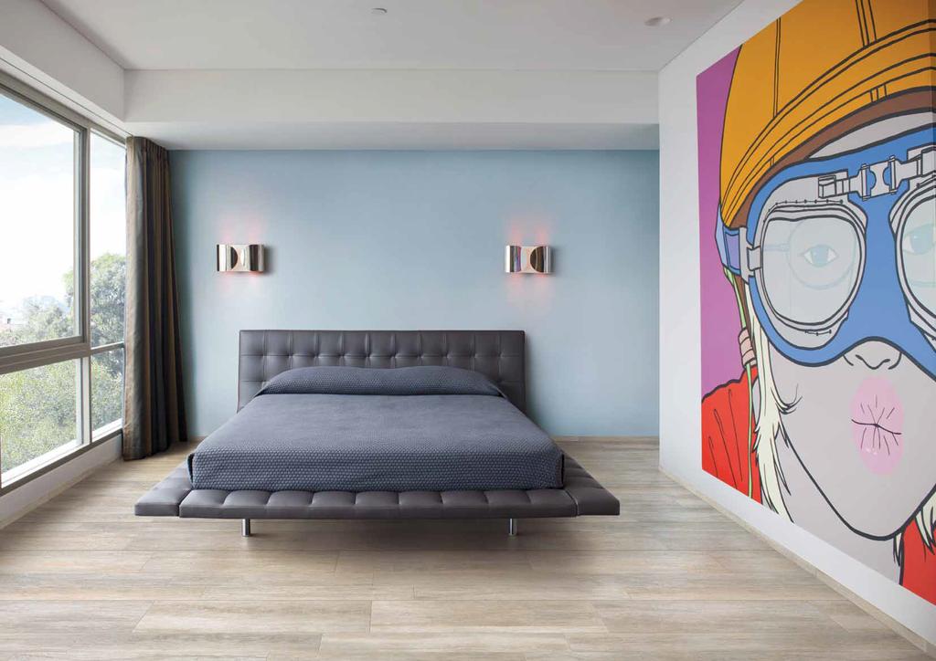 Slinutá dlažba s kresbou dřeva v ložnici Cerdomus Stage Pointe White
